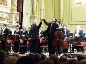 Cello soloist and Dresden music festival director Jan Vogler takes a bow with Manfred Honeck