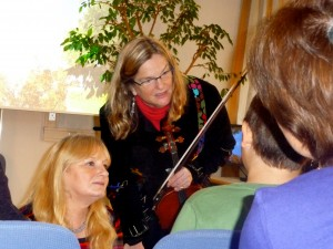 Violist Penny Brill listens to kids through a translator